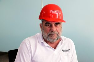 Henry Putney in a red Neumann hard hat