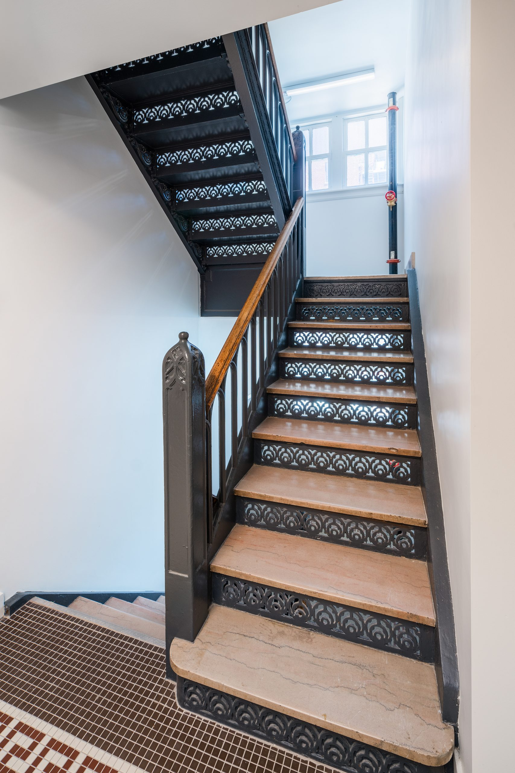 Restored stairs in Edna Griffin building displays original metal work