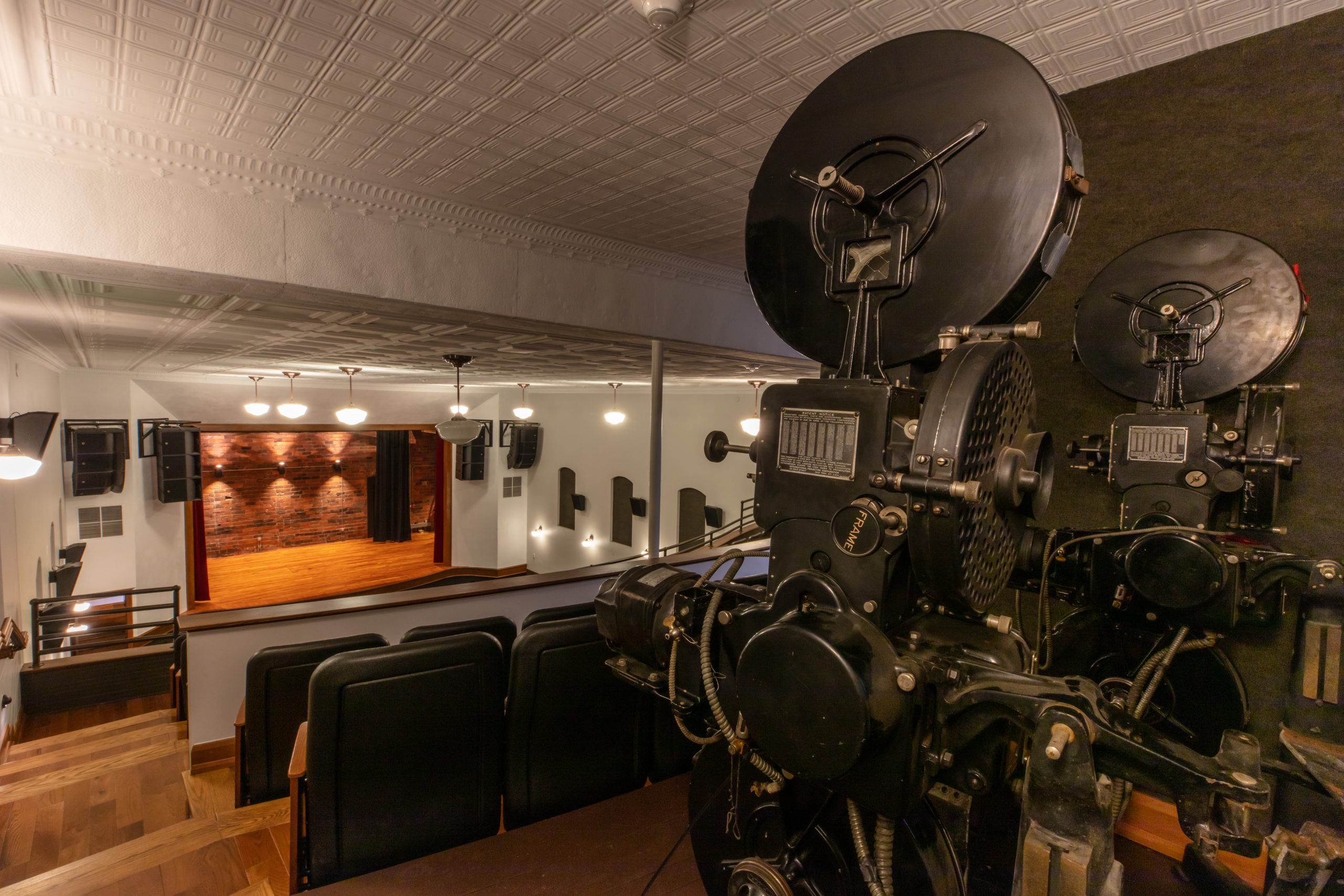Interior of Brooklyn Opera House viewing old original film equipment in the back of the balcony